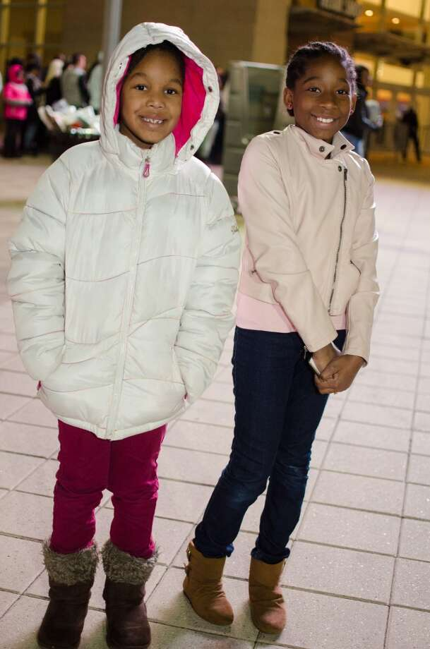 This lucky duo, Keaira and Keanna Lewis, will likely be the envy of  their classmates at school the next day. Photo: Jamaal Ellis, For The Chronicle