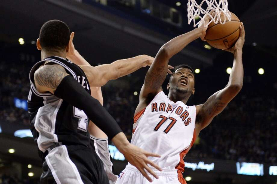 Toronto Raptors guard Julyan Stone (77) goes up for a shot as San Antonio Spurs forward Danny Green (4) defends during first half NBA basketball action in Toronto on Tuesday, Dec. 10, 2013. (AP Photo/The Canadian Press, Frank Gunn) Photo: Associated Press