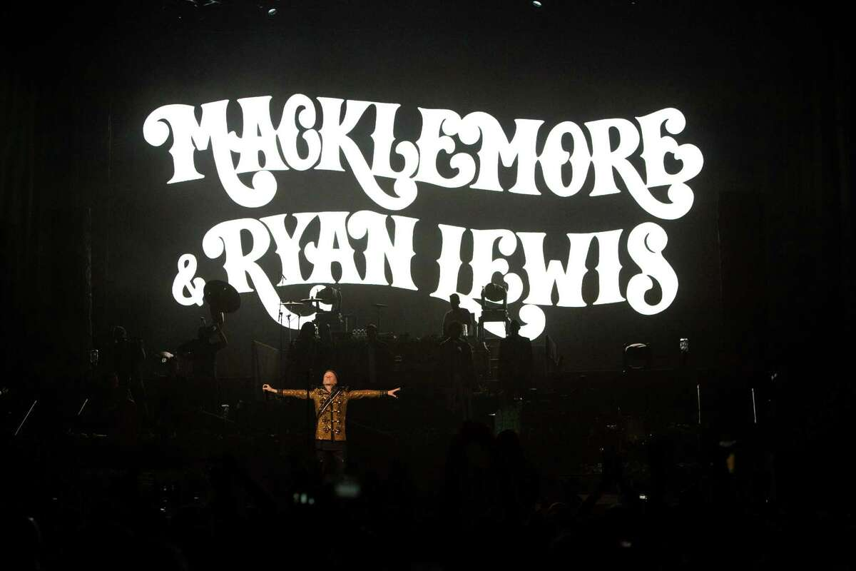 Seattle musicians Macklemore and Ryan Lewis perform with their posse at KeyArena for a hometown crowd during the last stop of their fall The Heist Tour.