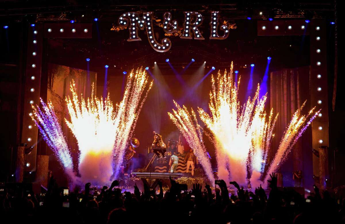 Pyrotechnics explode as Seattle musicians Macklemore and Ryan Lewis perform with their posse at KeyArena for a hometown crowd during the last stop of the fall