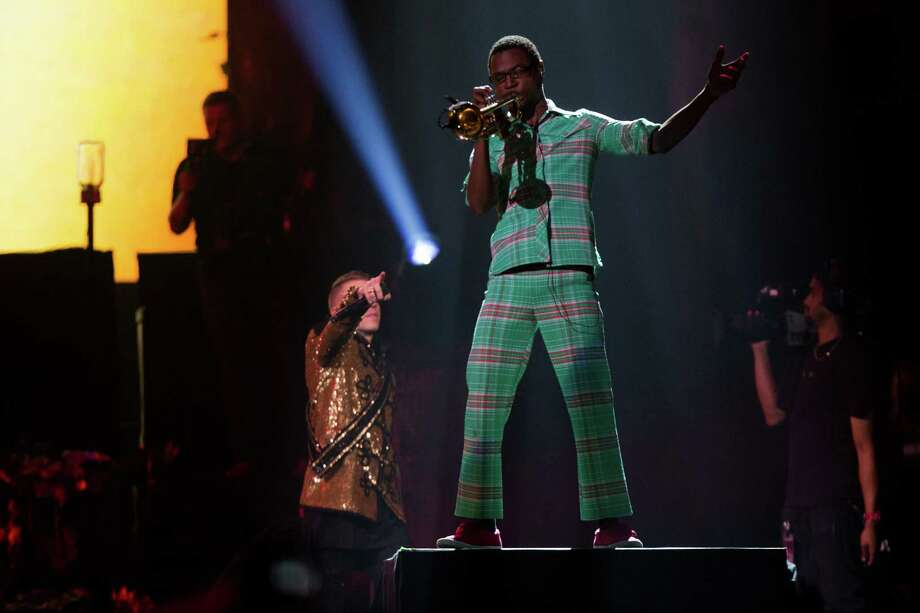 Seattle musicians Macklemore and  trumpet player Owuor Arunga perform along with Ryan Lewis at KeyArena. Photo: JOSHUA TRUJILLO, SEATTLEPI.COM / SEATTLEPI.COM