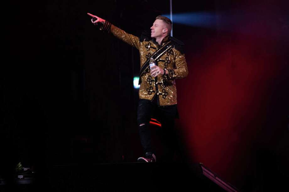 "Seattle musicians Macklemore and Ryan Lewis perform with their posse at KeyArena for a hometown crowd during the last stop of their fall ""The Heist"" tour. Photo: JOSHUA TRUJILLO, SEATTLEPI.COM / SEATTLEPI.COM"