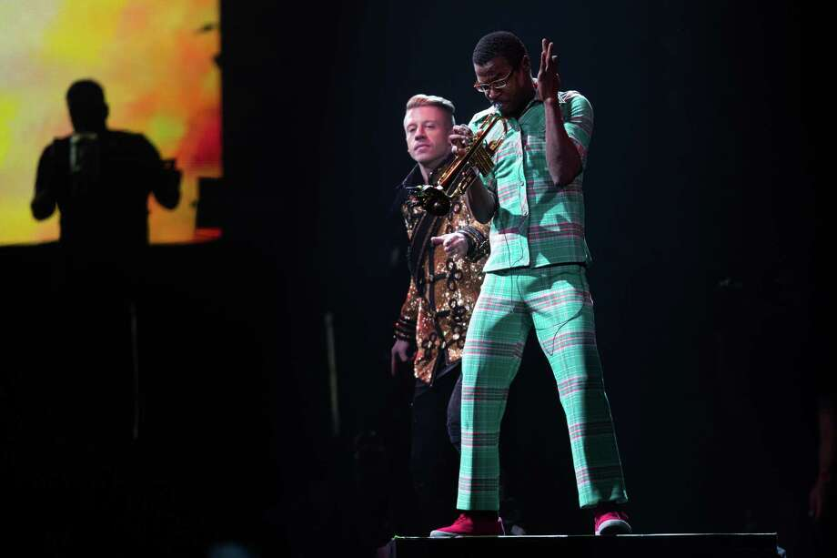 Seattle musicians Macklemore and  trumpet player Owuor Arunga perform along with Ryan Lewis at KeyArena for a hometown crowd. Photo: JOSHUA TRUJILLO, SEATTLEPI.COM / SEATTLEPI.COM
