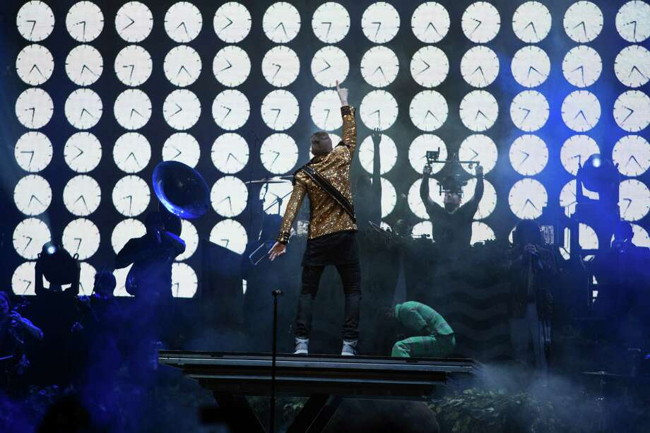 Seattle musicians Macklemore and Ryan Lewis perform with their posse at KeyArena for a hometown crowd. Photo: JOSHUA TRUJILLO, SEATTLEPI.COM / SEATTLEPI.COM