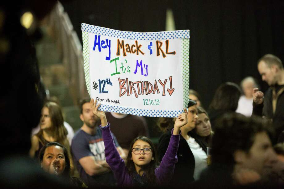 A young fan holds a sign during Macklemore and Ryan Lewis' performance. Photo: JOSHUA TRUJILLO, SEATTLEPI.COM / SEATTLEPI.COM