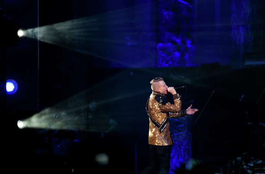 Seattle musicians Macklemore performs at KeyArena. Photo: JOSHUA TRUJILLO, SEATTLEPI.COM / SEATTLEPI.COM