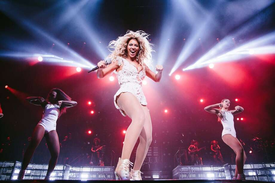 "Beyonce performs onstage at her  ""Mrs. Carter Show World Tour 2013,"" on Tuesday, December 10, 2013 at the Toyota Center in Houston, Texas. (Photo by Robin Harper/Invision for Parkwood Entertainment/AP Images) Photo: Robin Harper, Invision For Parwood Entertainme"
