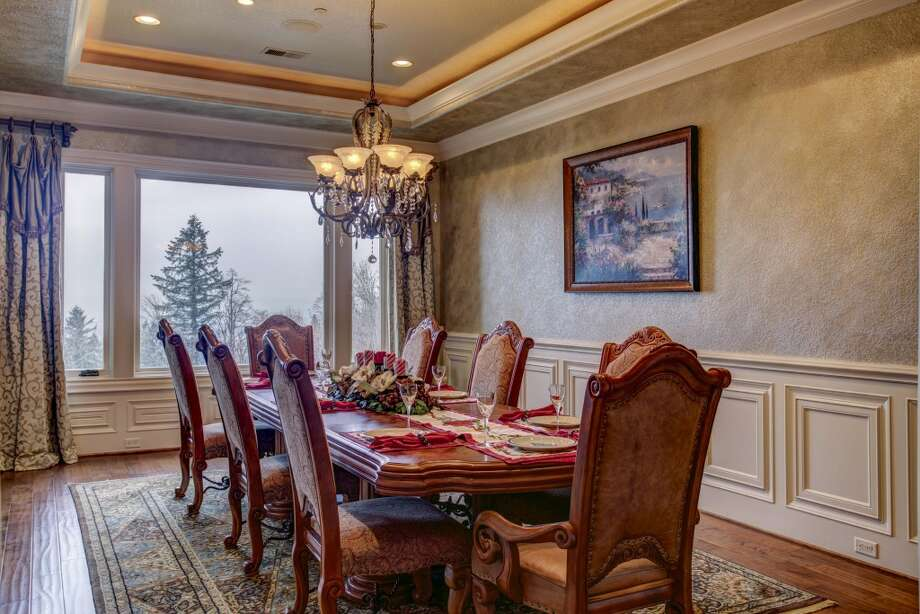 Formal dining room.  Photos via Cindy Oja, John L Scott. Photo: Kent SkewesBarefoot Studio