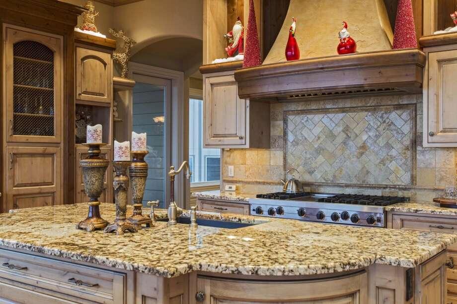 Close up of kitchen.  Photos via Cindy Oja, John L Scott. Photo: Kent SkewesBarefoot Studio