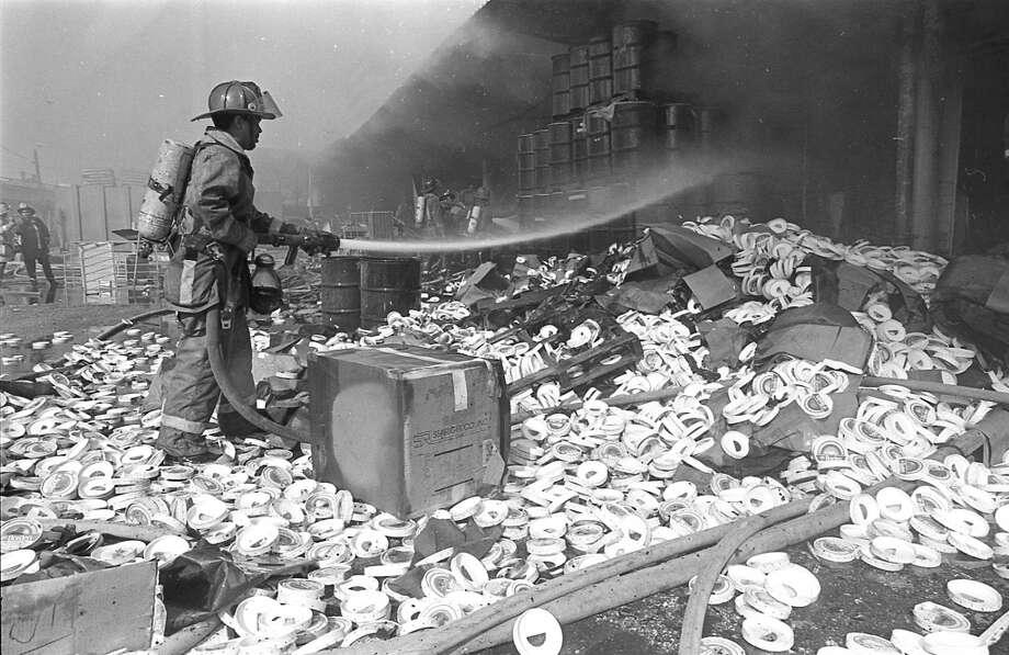 Firefighter at Borden's Ice Cream plant. Photo: John Everett, Houston Chronicle