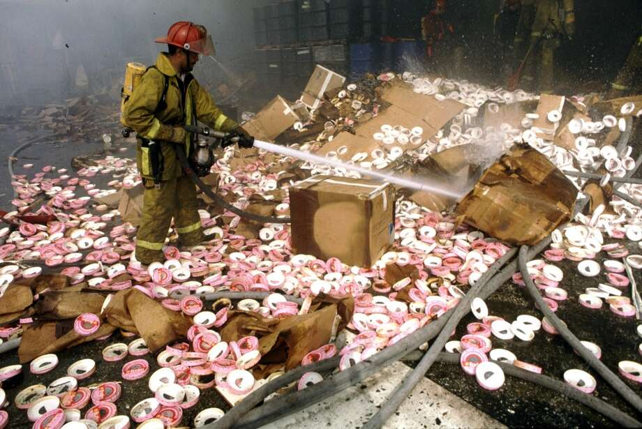 A firefighter at work at the Borden Ice Cream plant. Photo: Houston Chronicle