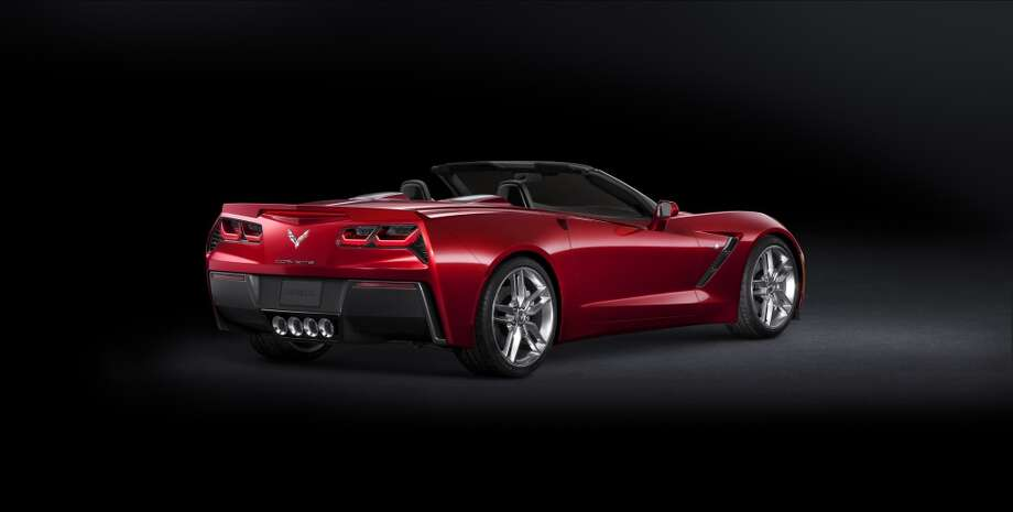 Behind the seat backs, dual black accent panels enhance the character lines of the tonneau cover. Corvette Stingray'€™s signature €'waterfall'€ design originates in the valley between the nacelles, bringing the exterior color into the interior. Photo: Courtesy General Motors
