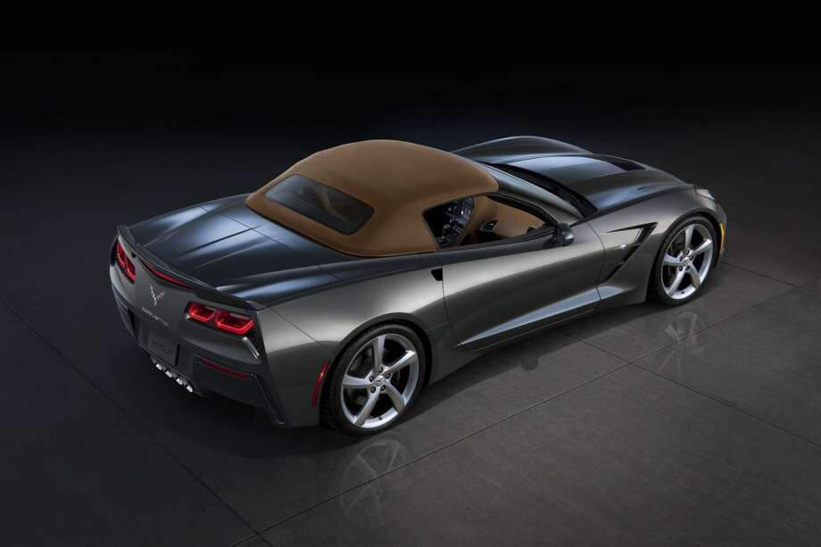 With the top up, the 2014 Corvette Stingray convertible is designed for a refined driving experience. A thick, three-ply fabric top, along with sound-absorbing padding and a glass rear window, contributes to a quiet cabin and premium appearance. Photo: Alan Vanderkaay, Courtesy General Motors