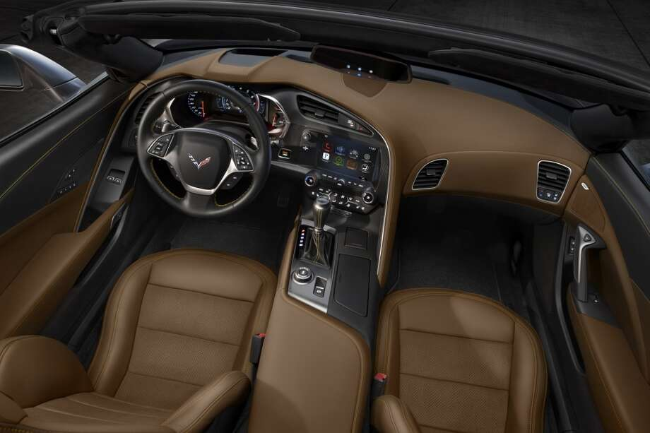 The all-new 2014 Chevrolet Corvette Stingray convertible interior blends fine materials and craftsmanship with advanced technologies to deliver a more connected and more engaging driving experience. Photo: Alan Vanderkaay, Courtesy General Motors