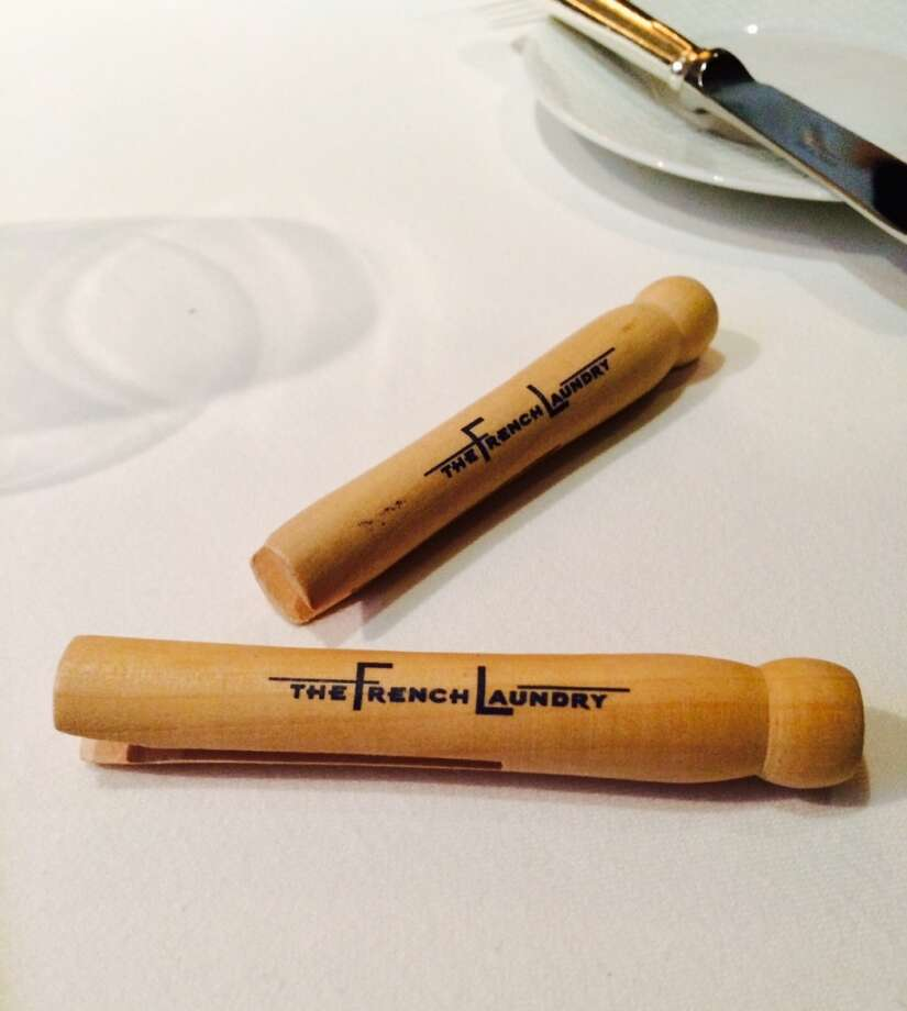 Diners are greeted at the French Laundry with oversized napkins clipped with a wooden clothespin