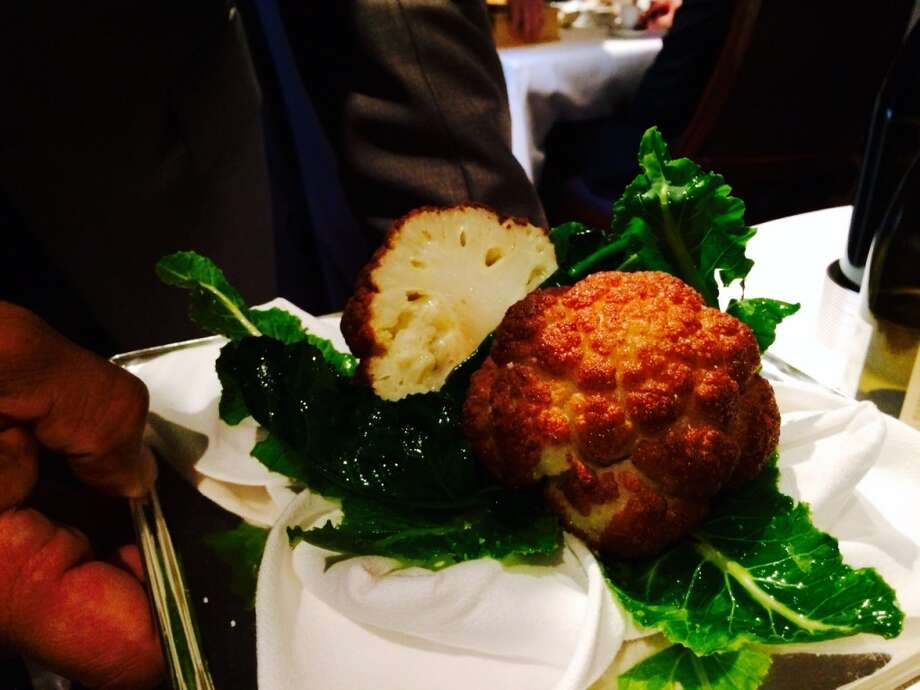 Slow-roasted cauliflower grown in the French Laundry garden is presented tableside