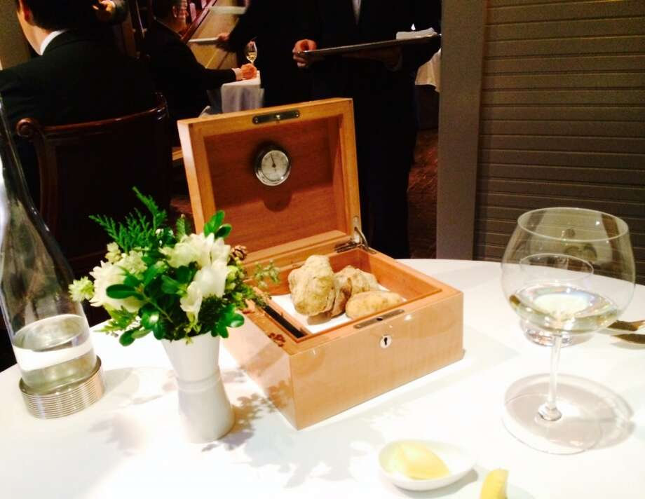 Then the waiter brings over a humidor with white truffles