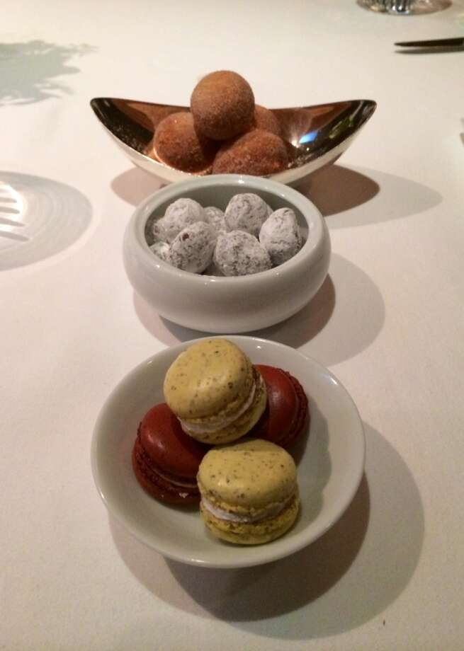 Macaroons, chocolate covered nuts and cinnamon sugar doughnuts