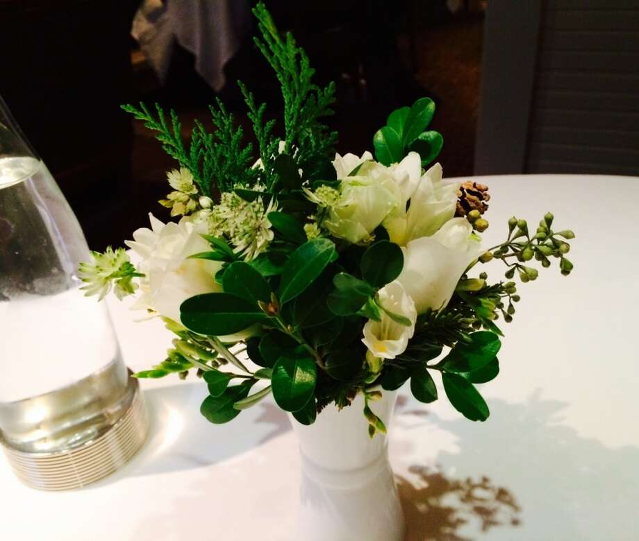The details: a close-up of the flower arrangement on each table