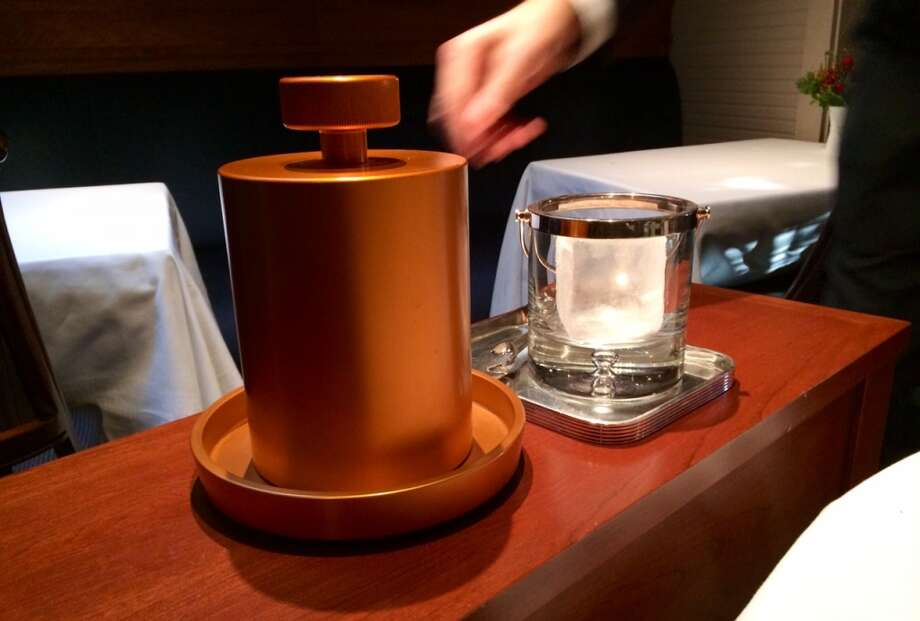 A special machine makes ice for the single- malt Scotch service