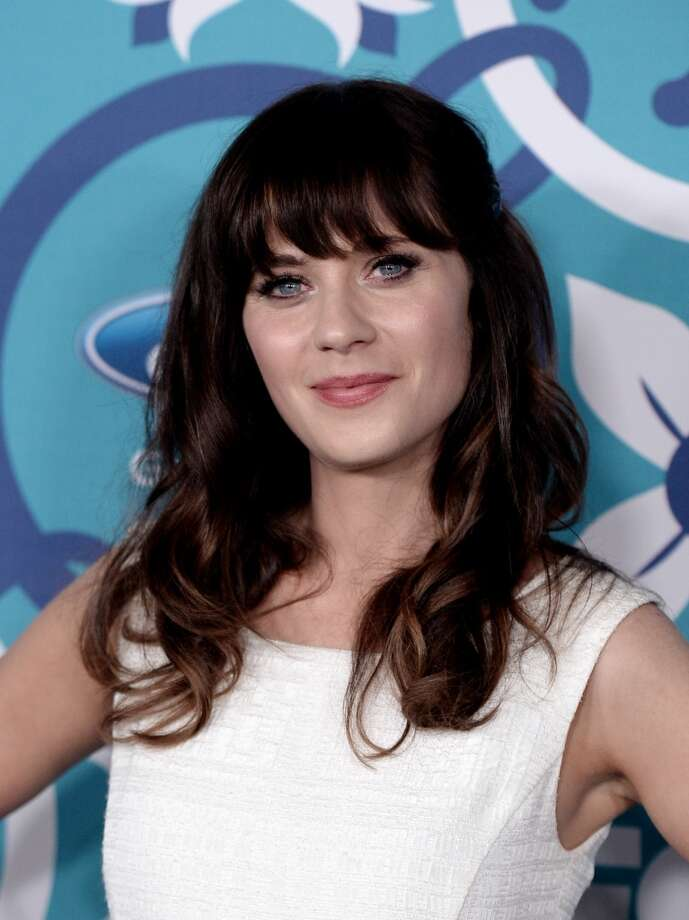 "Bangs. Credit folks like Zooey Deschanel and a certain Mrs. Obama for high-profile attention to this brow-grazing style. ""Hair is always huge on Yahoo every Saturday morning,"" says Clark, who guesses it's before their hair appointment. Photo: Kevin Winter, Getty Images"
