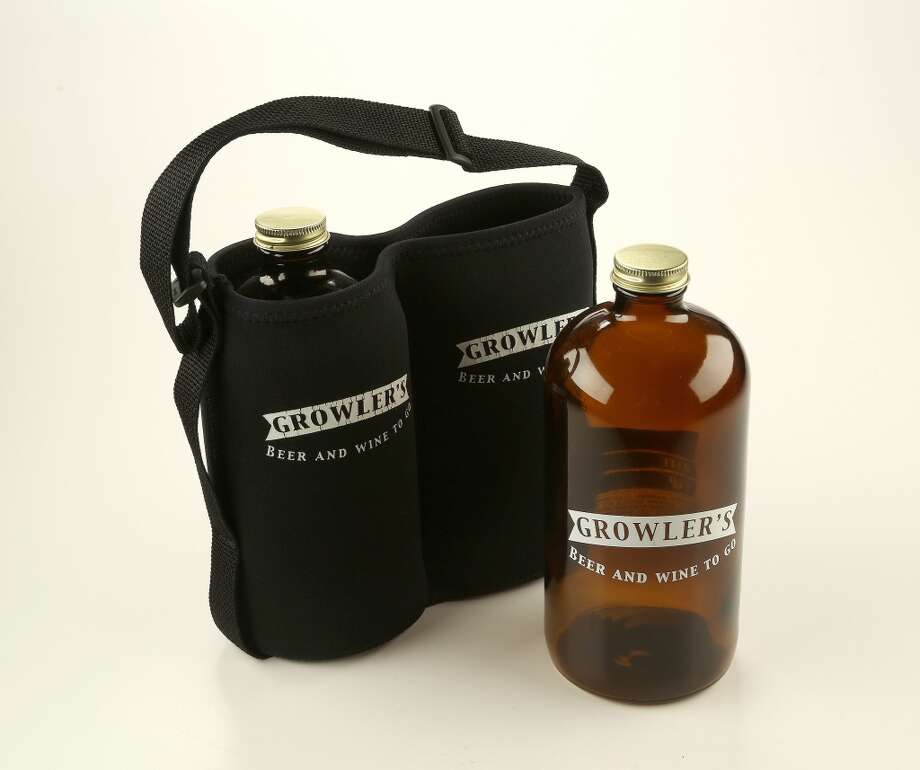 At least two local stores specialize in to-go beer poured into refillable jugs called growlers:  Premium Draught, 733 Studewood, and Growlers Beer and Wine To Go, 1005 Waugh. Both stores offer growlers in a variety of sizes, materials, designs and price ranges. This two-pack with a neoprene carrier is handy for bringing beer to parties and other outings. Photo: Karen Warren, Houston Chronicle