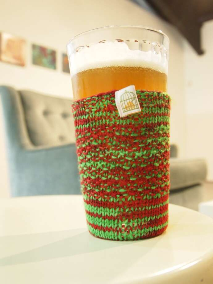 Hand-knit BeerSox -- like this one, in Christmas colors -- are available from Houston's The Caged Yarn for $20. Find them online or at Premium Draught. Photo: The Caged Yarn