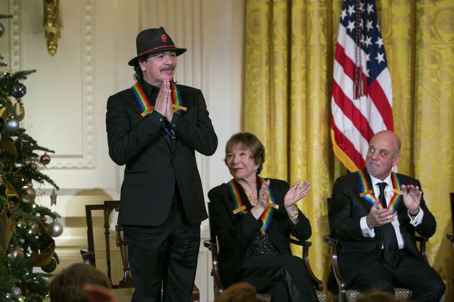 Kennedy Center honorees Carlos Santana (from left), Shirley MacLaine and Billy Joel attend a reception at the White House for the 2013 Kennedy Center Honorees. Photo: Getty Images