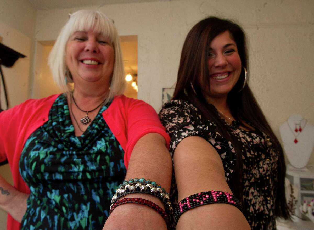 Sandy D'Andrea and her daughter, Stevie, owners of Jewels for Hope, pose for a photo in their Stamford home on Friday, December 6, 2013.