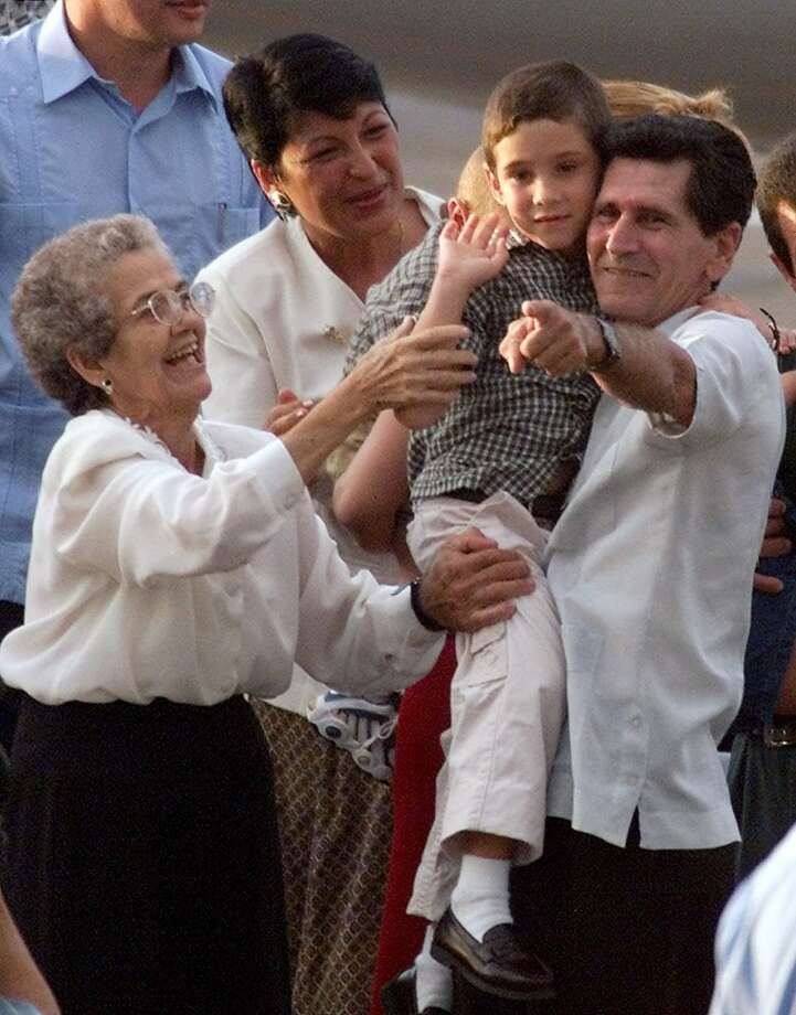 RETRANSMISSION TO ADD GREAT GRANDMOTHER'S LAST NAME-The grandfather of Elian Gonzalez, Juan Gonzalez, right, and his great grandmother Ramona Garrido, left, tell Elian to wave to schoolmates at Havana international airport , Wednesday, June 28, 2000.   (AP Photo/Jose Goitia) Photo: AP
