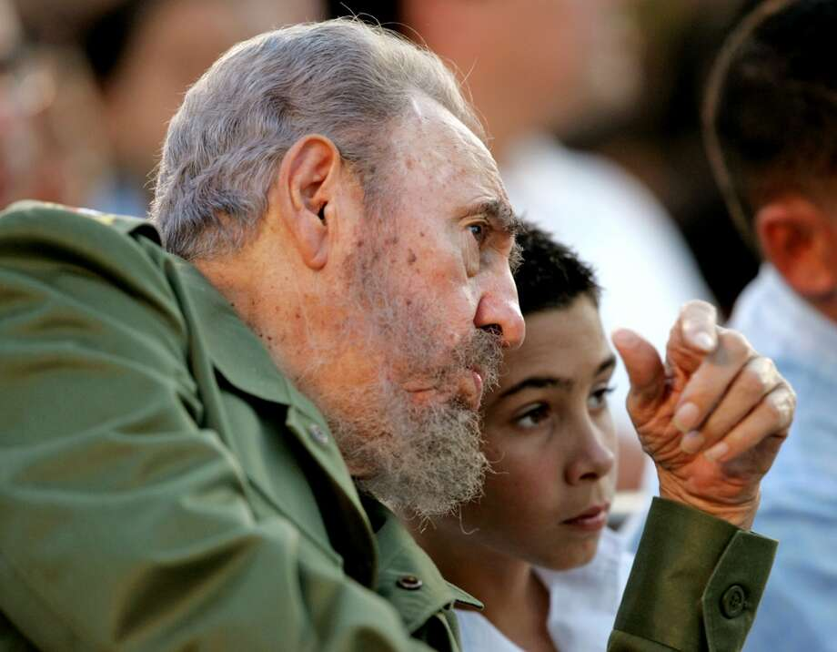 Cuba's President Fidel Castro (L) talks to Elian Gonzalez during a political rally in celebration of Elian's 12th birthday in Cardenas, Cuba December 6, 2005. Elian is the shipwrecked boy who was travelling illegally with his mother and other passengers from Cuba to the U.S in November 1999. His mother and most of the others died when their boat capsized and Elian was placed with family members in Miami. He finally returned to his father in Cuba on June 28, 2000, after a fierce international custody battle.  REUTERS/Claudia Daut Photo: REUTERS