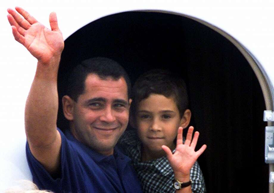 RETRANSMITTED FOR ALTERNATE CROP-Elian Gonzalez with his father Juan Miguel Gonzalez waves aboard a jet bound for Cuba at Dulles Airport Wednesday, June 28, 2000. The U.S. Supreme Court refused to hear the Miami relatives' appeal to keep Elian in the United States, clearing his return to Cuba. (AP Photo/Pablo Martinez Monsivais)  HOUCHRON CAPTION (09/14/2000):  Juan Miguel Gonzalez and Elian Gonzalez. Photo: AP