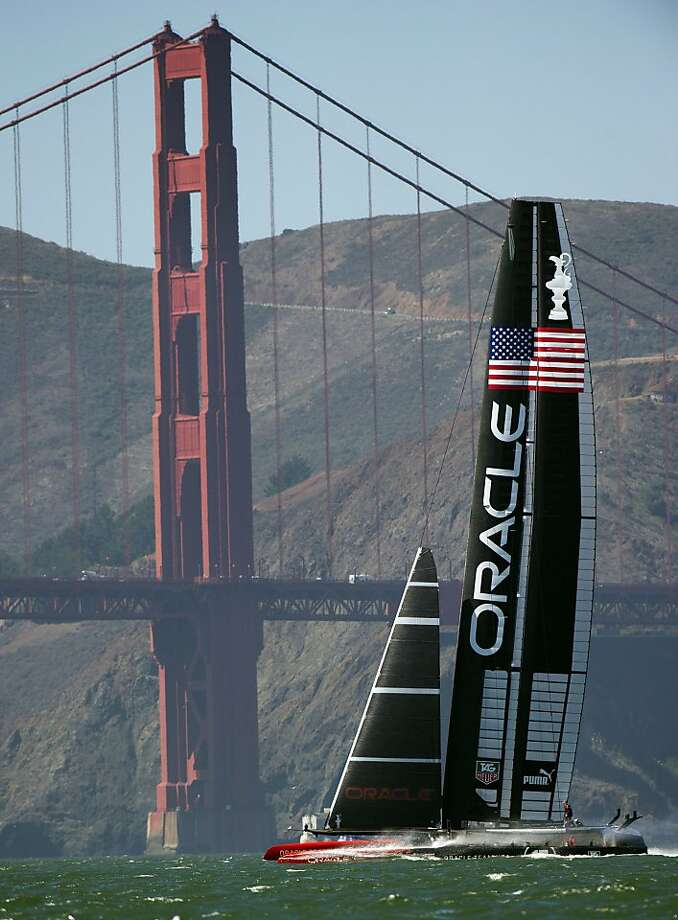 Oracle Team USA sails near the Golden Gate Bridge during the 34th America's Cup September 19, 2013  in San Francisco. Team USA won the first race of the day and the second was postponed due to high winds. AFP PHOTO/Don EmmertDON EMMERT/AFP/Getty Images Photo: Don Emmert, AFP/Getty Images