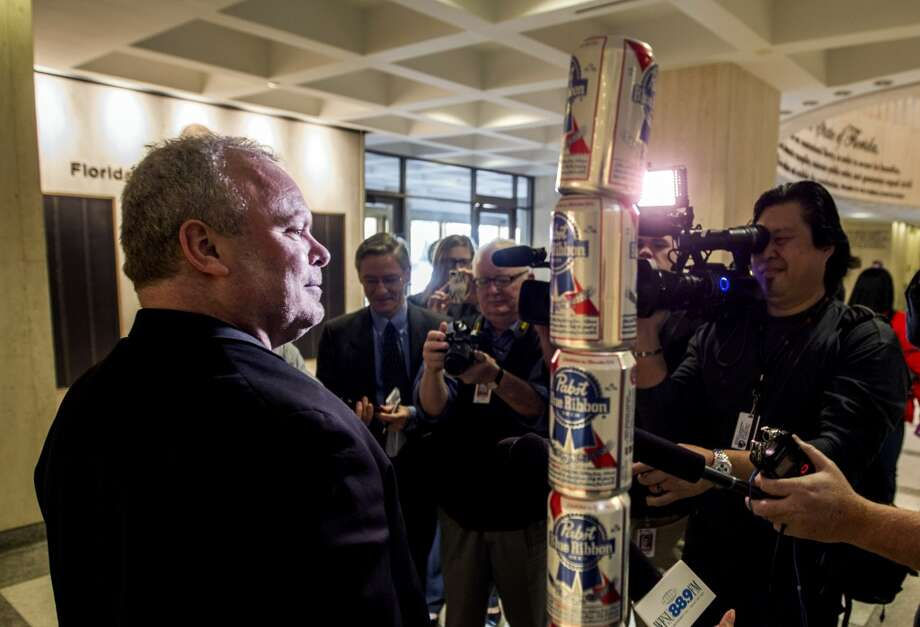 Chaz Stevens from Deerfield Beach, Florida talks to the media next to his Festivus pole made out of beer cans in the rotunda of the Florida Capitol December 11, 2013 in Tallahassee, Florida. Stevens display was intended to counter the religious Christian Nativity manger also on display. Based on an episode of the television sitcom Seinfeld, Festivus has become a secular holiday celebrated on December 23 to represent the antithesis of the commercialism of the Christmas season. (Photo by Mark Wallheiser/Getty Images) Photo: Mark Wallheiser, Getty Images