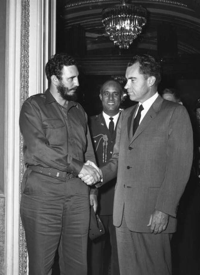 Cuban President Fidel Castro shook hands with the American Vice President  Richard Nixon during a press reception in Washington. The Cuban revolutionary is a controversial figure among the West as a harsh dictator of an impoverished nation. He stepped down in recent years and the country is now ruled by his brother Raul.