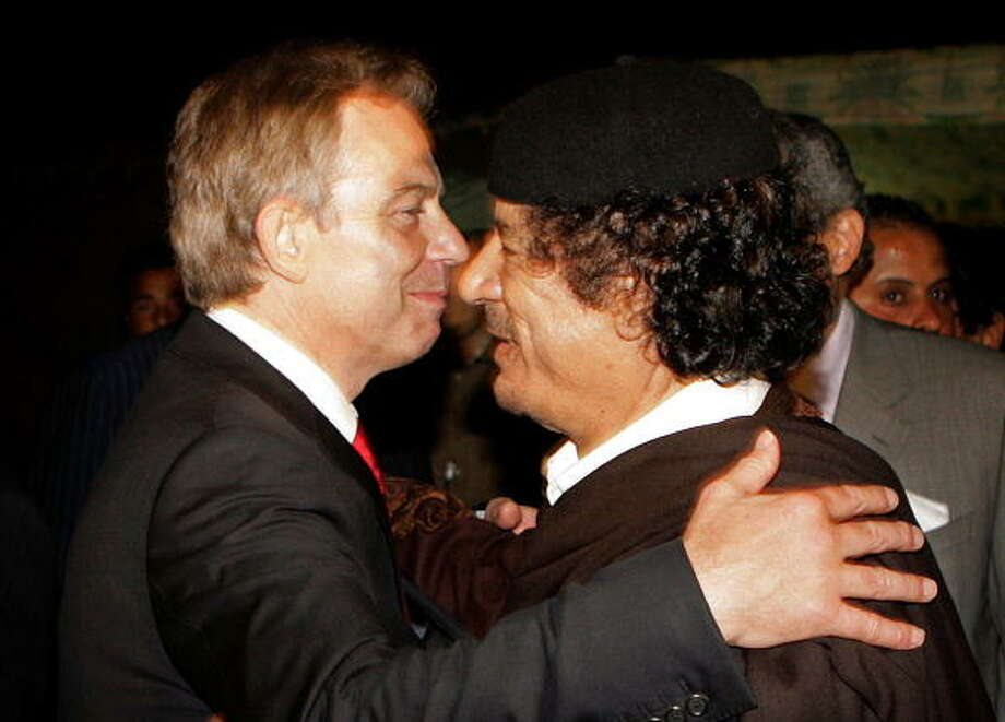 British Prime Minister Tony Blair (L) embraces Libyan dictator Colonel Moammar Gadhafi after a  meeting  on May 29, 2007 in Sirte, Libya. Gadhafi was accused of being a dictator and human rights violator. He was later captured and killed by militants in 2011.  / 2007 Getty Images