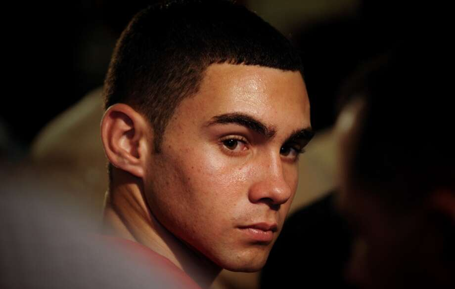 FILE - In this June 30, 2010 file photo, Elian Gonzalez attends an official event with Cuba's President Raul Castro in Havana, Cuba. The young Cuban raft boy who was the subject of a high-profile international custody dispute more than a decade ago, turned 20 on Friday, Dec. 6, 2013. Cuban state media report that Gonzalez is in Ecuador as part of a delegation of the World Festival of Youth and Students, his first trip overseas trip since he was reunited with his father in 2000. (AP Photo/Adalberto Roque, File Pool) Photo: Associated Press