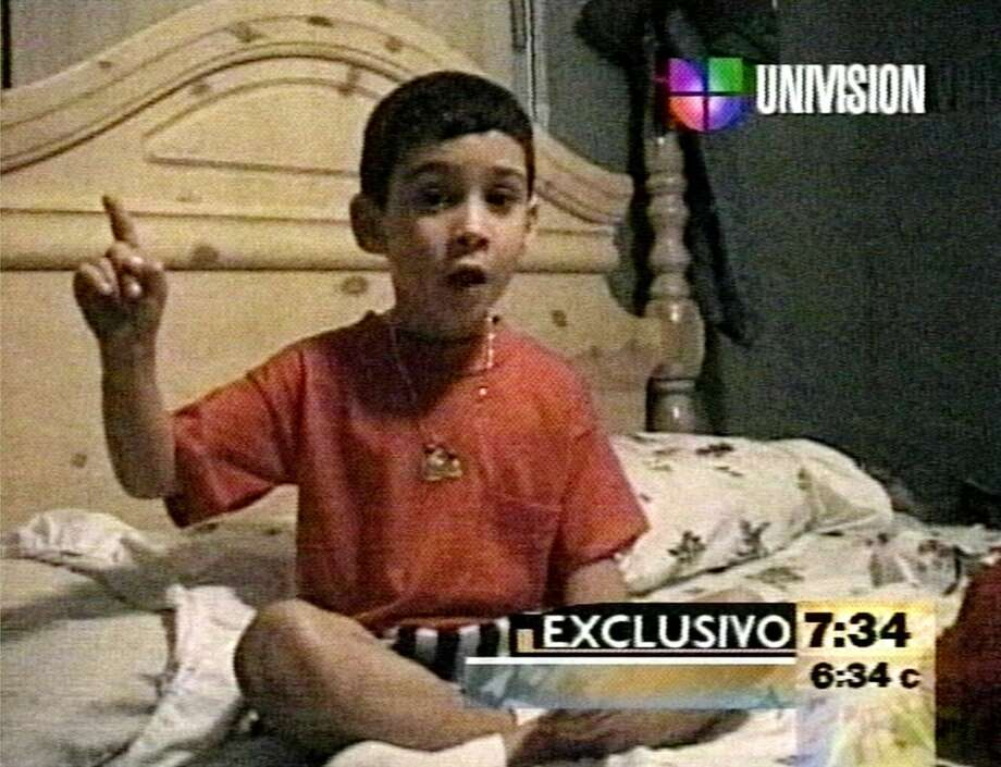 In this image from a television broadcast April 13, 2000 on Univision, six -year-old Elian Gonzalez is seen in a home video. Elian, speaking in Spanish addressed his father, saying: ``I don't want to go to Cuba. ... I want to stay here.'' The video was obtained by Univision and shown today on ABC's ``Good Morning America.'' The translation was by ABC. (AP Photo/Univision)  HOUCHRON CAPTION (04/14/2000):  A videotape of Elian Gonzalez saying he does not wish to return to Cuba was released Thursday by his relatives in Miami. Photo: AP