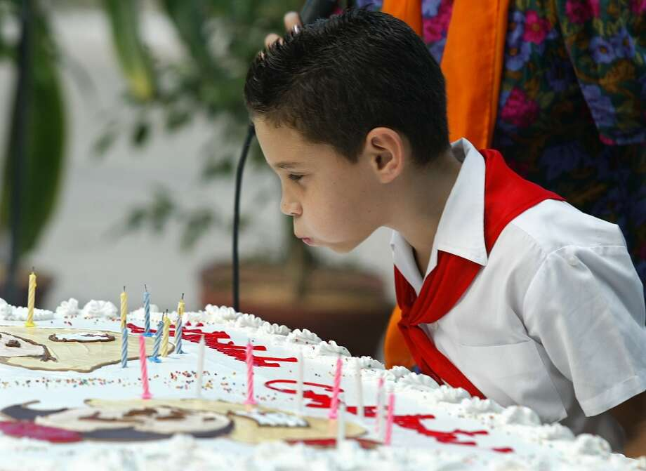 Cuban boy Elian Gonzales blows out the candles of his birthday cake at his 9th birthday celebration in Cardenas, east of Havana, Friday Dec.6,2002 in Cardenas, East of Havana, Cuba.  Life has never been the same for the child since an ill-fated attempt to take him to the United States left his mother dead and made him the focus of an international tug-of-war between relatives in Miami and his father in Cardenas. Castro attended the celebration for the famous boy.(AP Photo/Jose Goitia)   HOUCHRON CAPTION (12/07/2002):  Elian Gonzalez blows out the candles on his cake Friday during a celebration of his ninth birthday in Cardenas, near Havana. Among those attending was Cuban leader Fidel Castro. Photo: AP