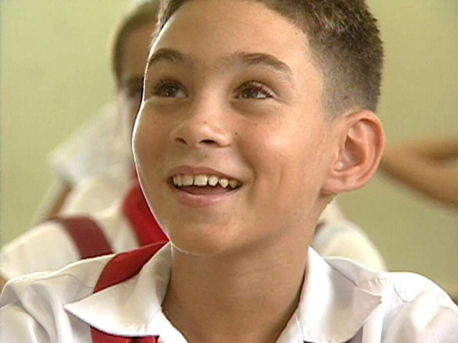"This undated image made available Thursday, Sept. 29, 2005 by CBS shows Elian Gonzalez, 11, in his seventh-grade classroom in Cuba. Gonzalez, the Cuban boy at the center of an international custody battle five years ago, calls Cuban President Fidel Castro his friend but also says he hopes someday to see his Miami family again. ""Despite everything they did, it was wrong, they are (still) my family ... my uncles,"" the boy said in the interview with CBS's ""60 Minutes,"" which released excerpts Thursday for the program that airs Sunday night, Oct. 2. (AP Photo/ CBSNews, 60 Minutes) Photo: AP"