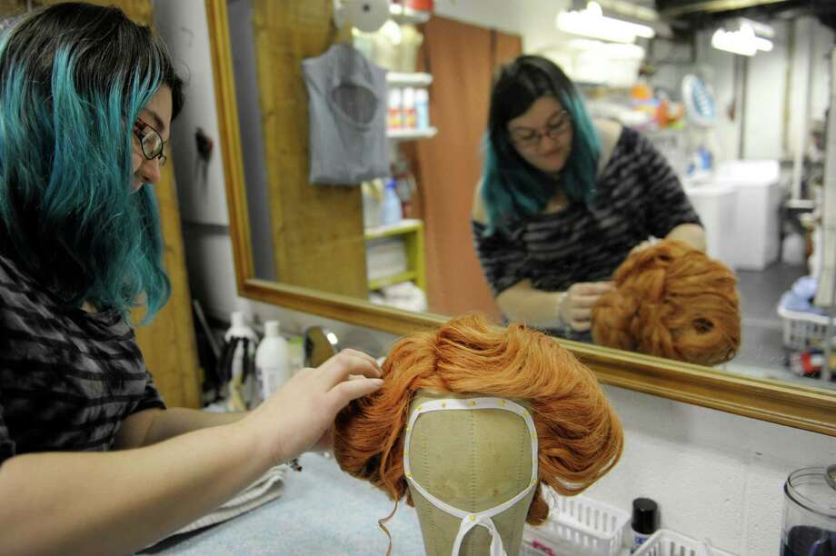 Carolyn Walker, costume shop manager, works on the wig worn by the Ghost of Christmas Present at Capital Rep on Thursday, Dec. 5, 2013 in Albany, NY.     (Paul Buckowski / Times Union) Photo: PAUL BUCKOWSKI / 00024908A