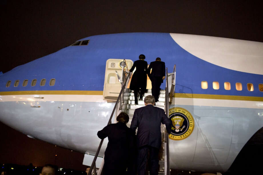 The Bush's and Obama's board Air Force One in Johannesburg. (Official White House Photo by Pete Souza)
