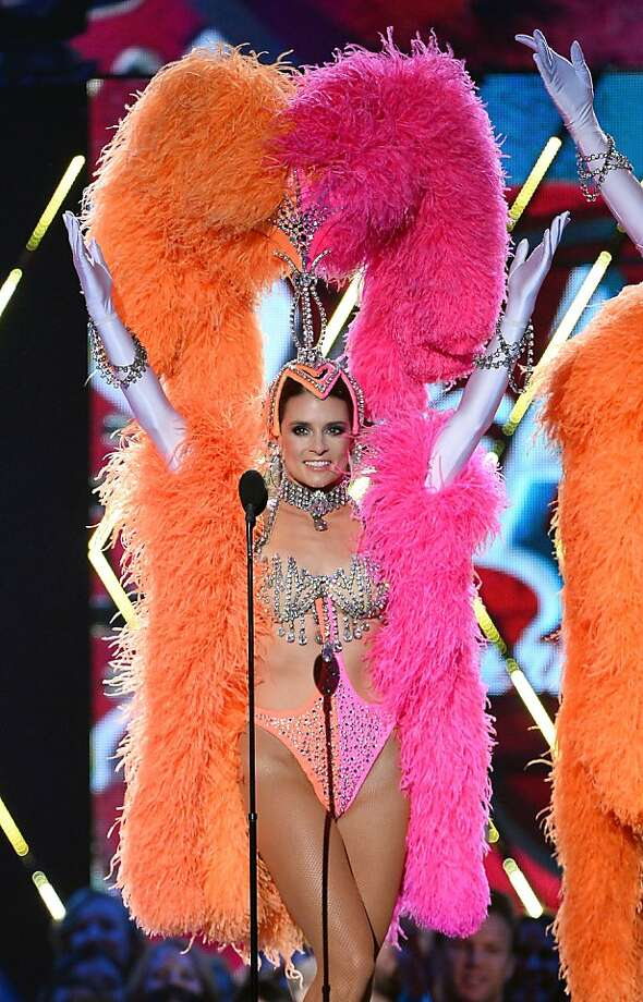Glad they picked her and not Dale Earnhardt Jr.:NASCAR driver Danica Patrick struts on stage in a flesh-colored bikini and feathers during a dance routine for