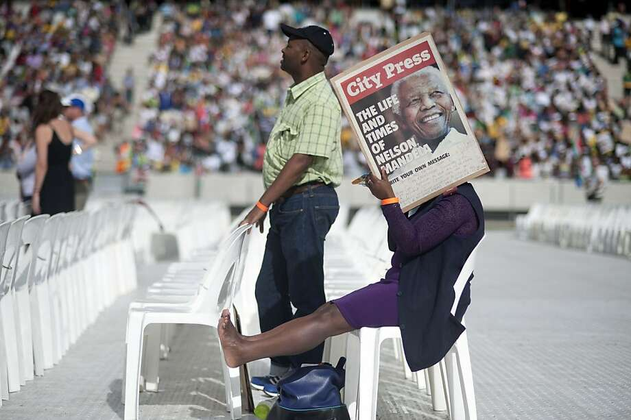 "Mandela memories: A Nelson Mandela supporter rests her legs during a concert called ""A Life Celebrated"" in 