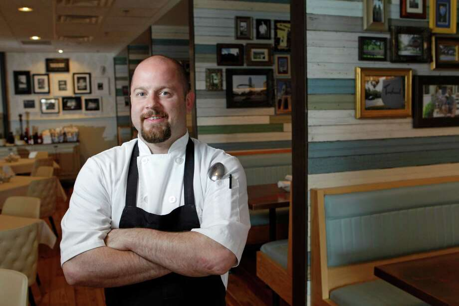 Chef Travis Lenig presides over the kitchen at glossy new Liberty Kitchen & Oysterette in the River Oaks area. Photo: Melissa Phillip, Staff / © 2013  Houston Chronicle