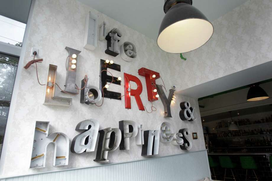 The signage at Liberty Kitchen & Oysterette. Photo: Melissa Phillip, Staff / © 2013  Houston Chronicle