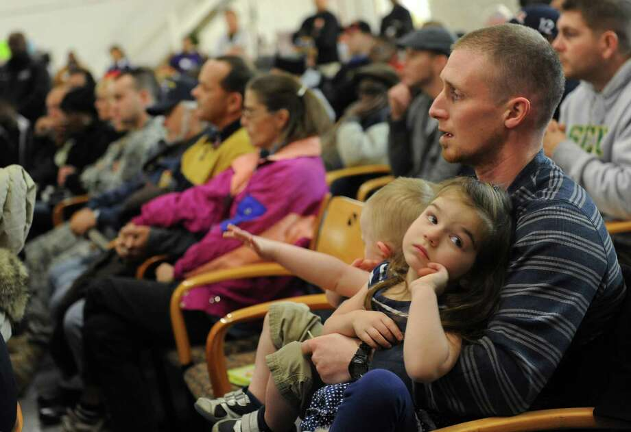 Army veteran Michael Crachi of Niskayuna holds his children Jonathan, 2, and Ashlyn, 3, during a veteran's appreciation day at Jezreel International  Wednesday, Dec. 11, 2013, in Colonie, N.Y. Jezreel International, along with Town and City officials, honored local veterans by providing new clothes, personal care and hygiene products, and Christmas toys. (Lori Van Buren / Times Union) Photo: Lori Van Buren / 00024978A