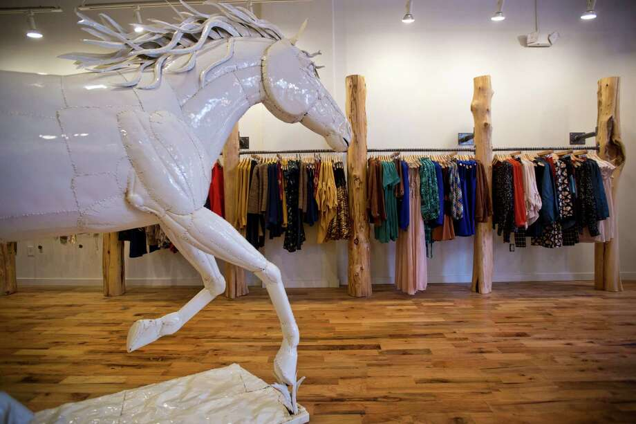 Above: The new Langford Market store has special rustic details such as an artful, lifesize aluminum horse. Below: Jewelry finds are mostly priced under $40. Photo: Marie D. De Jesus, Staff / © 2013 Houston Chronicle
