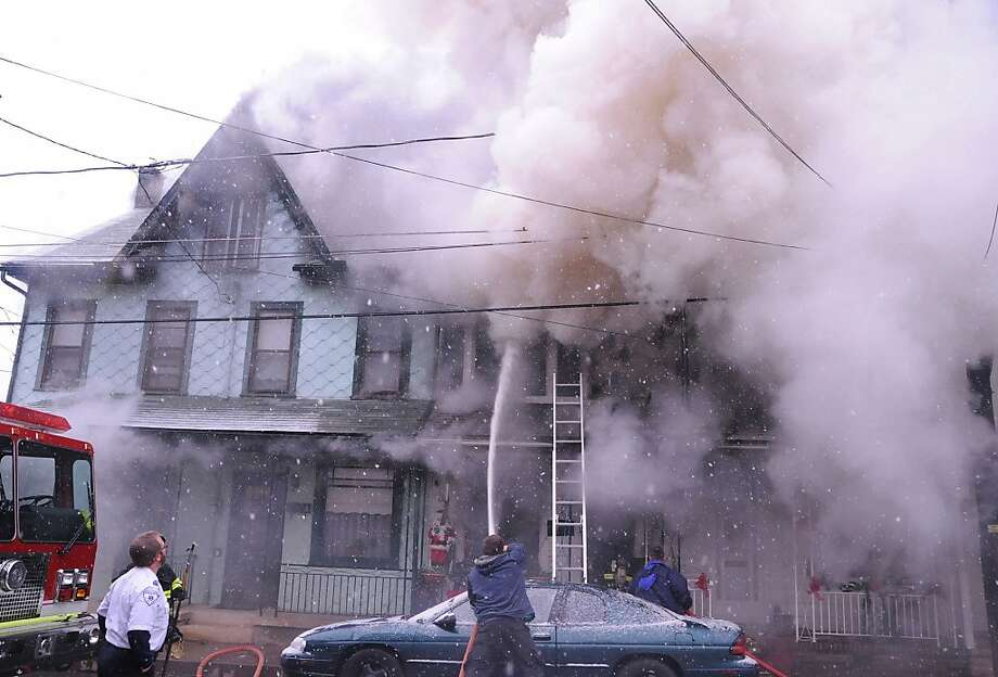 Fatal fire:Smoke billows from a fire that destroyed five row homes on South Rock Street in Shamokin, Pa. A 13-year-old girl died in the blaze. Photo: Mike Staugaitis, Associated Press