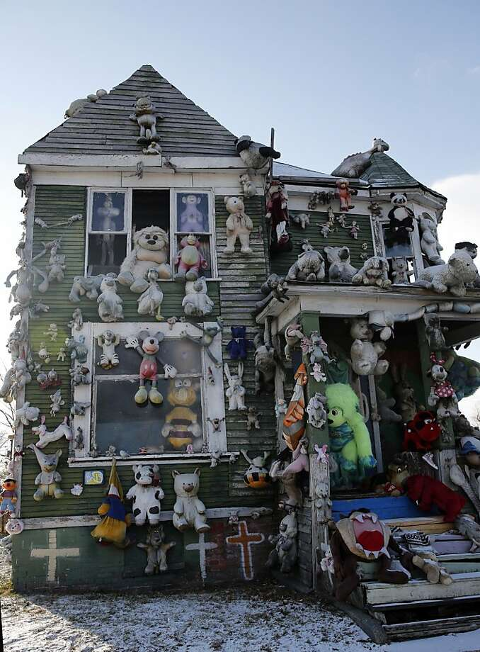 "Art houses targeted:Studded with stuffed animals, the ""Polka Dot House"" has so far escaped arsonists who have burned down five vacant homes of the Heidelberg Project outdoor art installation in Detroit. The latest blaze on Dec. 8 destroyed an empty house decorated with painted clocks. The Heidelberg Project's quirky homes have drawn curiosity seekers from around the world. Photo: Jeff Kowalsky, Bloomberg"